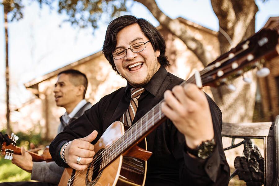 Trinidad Agosto plays the guitar