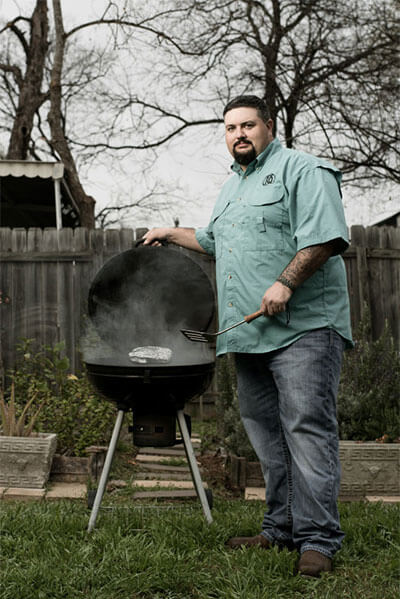 Jeff Rankin grilling on a barbecue