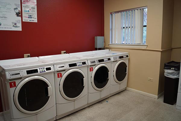 Coin-operated laundry room in Cremer Hall