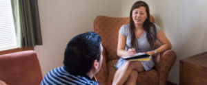 A student provides affordable counseling to a San Antonio patron