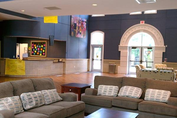Common area lounge in Founders Hall with comfy sofas