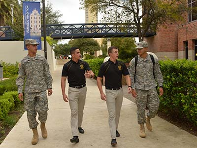 Military science students walk under the UC bridge