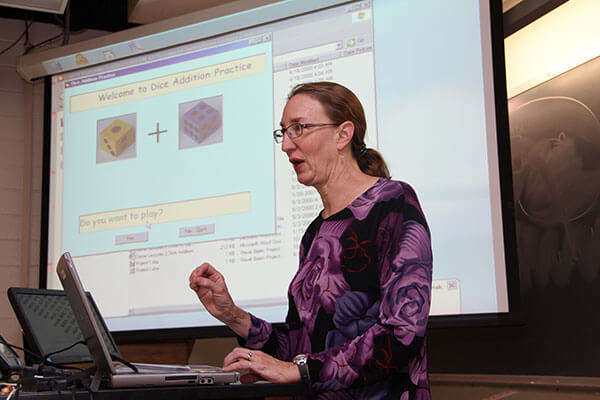 Carol Redfield, Ph.D., instructs a Computer Science class.