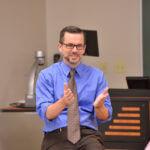 Professor leading class discussion