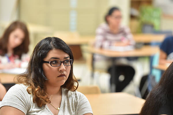 Biology student Bianca Romo listens in class.