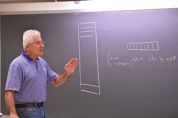 Arthur Hanna, Ph.D., teaches a Computer Science course.