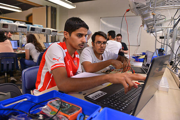 Electrical Engineering students work in lab.