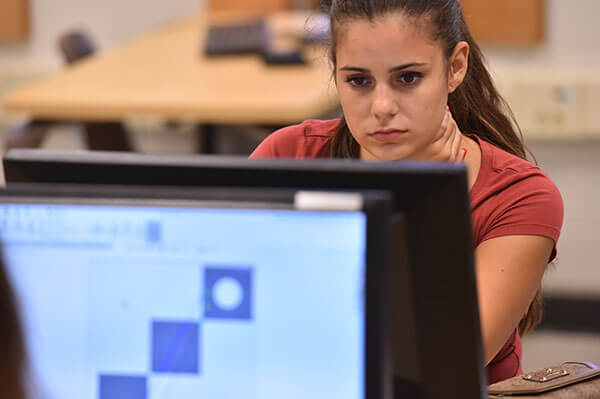 Student working in Engineering Graphic Design class.