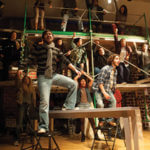 Image of students performing in the musical called Rent.