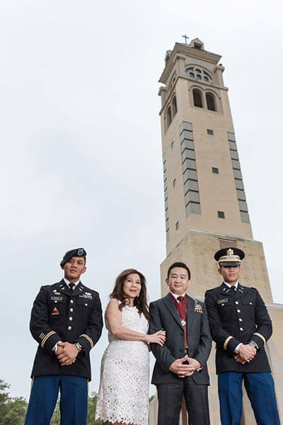 From left, Capt. Jules Chan (B.B.A. '08), his mother Vanessa (M.A. '98), father Julius and younger brother Jed Chan (B.A. '15).