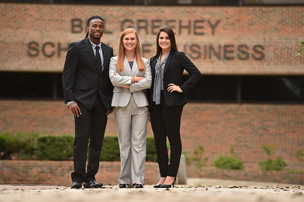 Greehey Scholars outside of Alkek Business Building