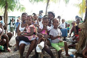 A Haitian mother and her children at a health clinic