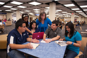 Kathleen Maloney in the library with students