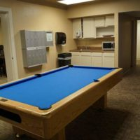 Lounge at Lourdes Hall featuring a pool table, vending machine, mini kitchen and study area