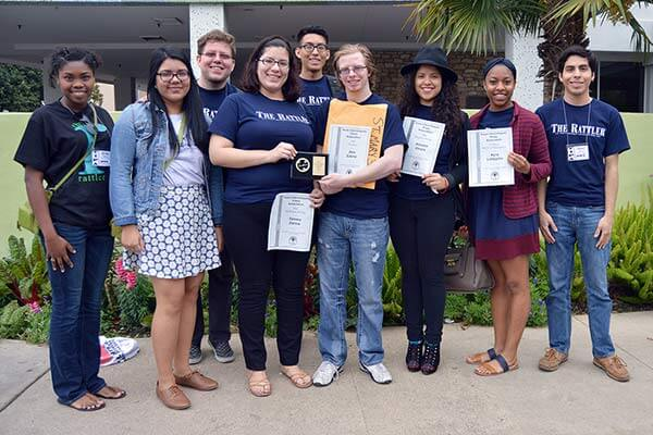 Rattler staff members holding their hard-earned awards