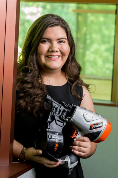 Sarah Cantu poses with a large power tool