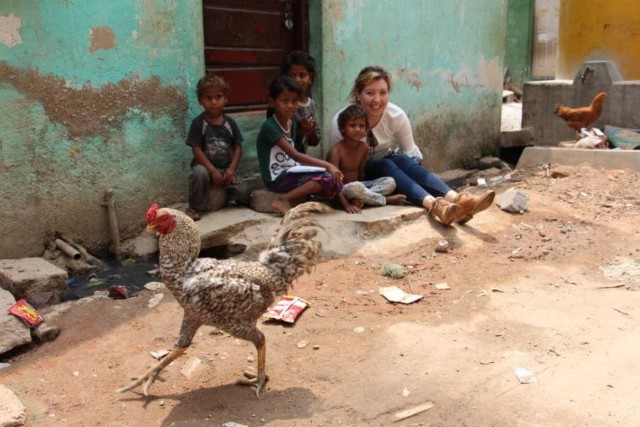 St. Mary's University student Gisell Orozco reads a book with a group of children on the streets of Bangalore's slums.