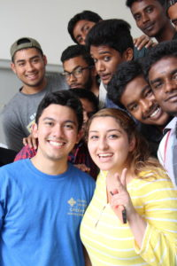 St. Mary's University undergraduates make friends with students from GMR's skills training programs.