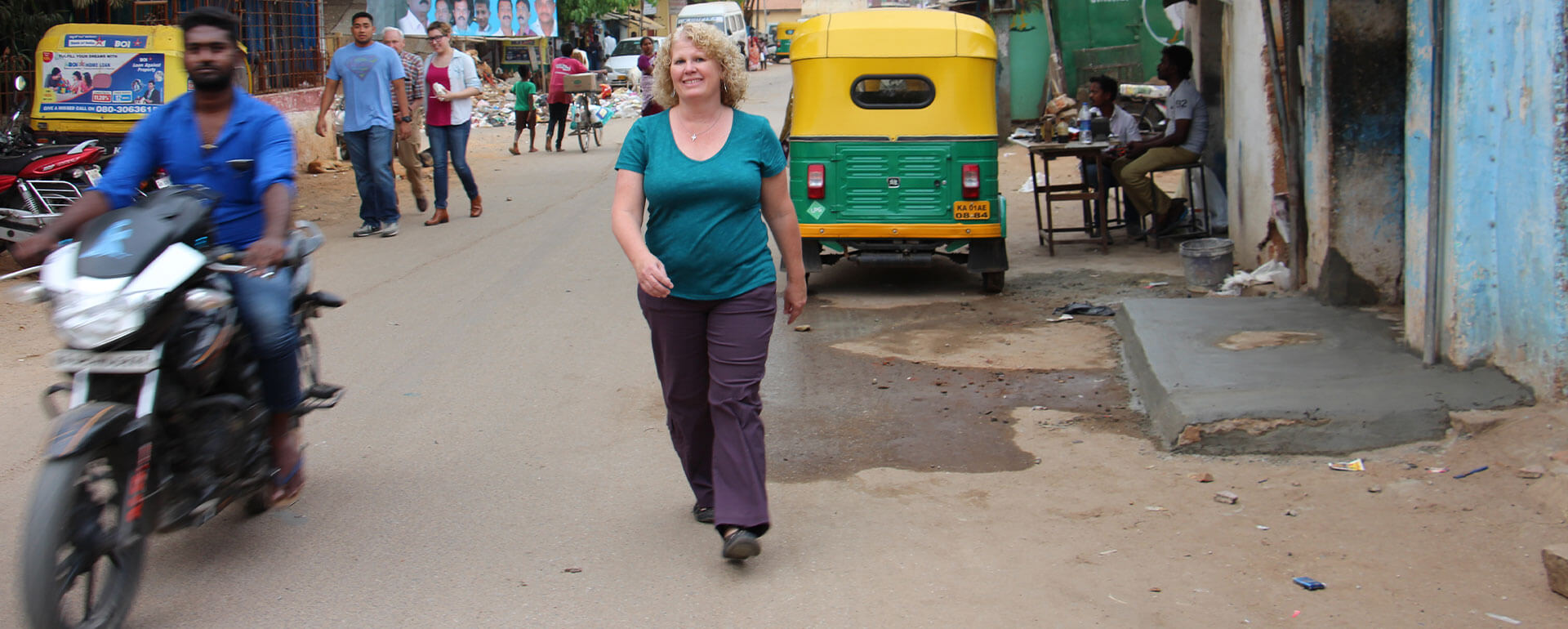 Stephanie Ward walks through a slum in Bangalore.