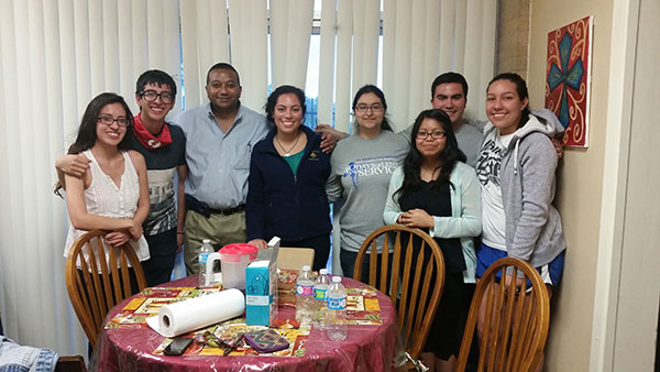 Dean Winston Erevelles with students living in Marian Hall.