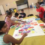 Children finger painting at the Summer of Service Program.