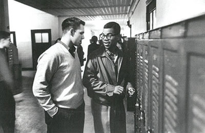 Louis Cousins at Maury talking to a fellow student.