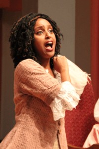 Vocal music student sings expressively in a Cinderella opera performance on campus
