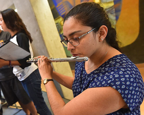 Female student playing the flute