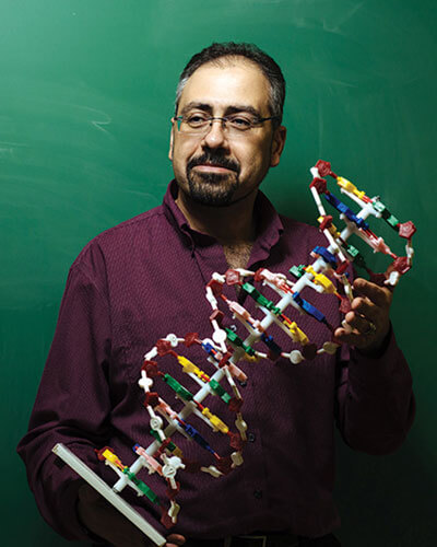 Dr. Galeleldeen with a model of DNA