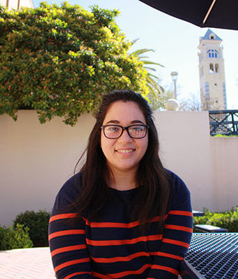 Iliana De La Cruz sits by the Cotrell Commons.