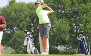 An StMU golfer takes a swing