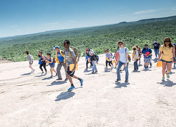 Students walking to the summit of Enchanted Rock.