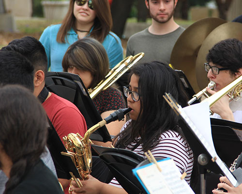 A group of students playing various instruments