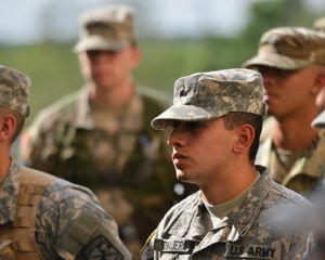 Profiles of four ROTC cadets in uniform