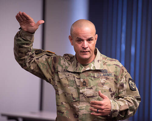 ROTC instructor gesturing with his hands