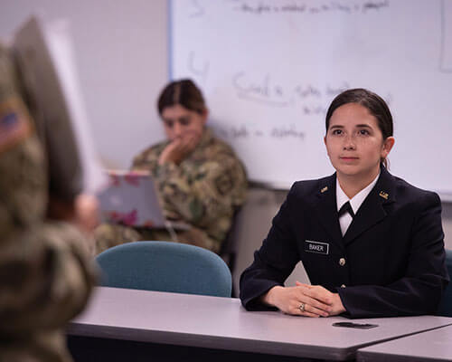 ROTC student listening to instructor in classroom