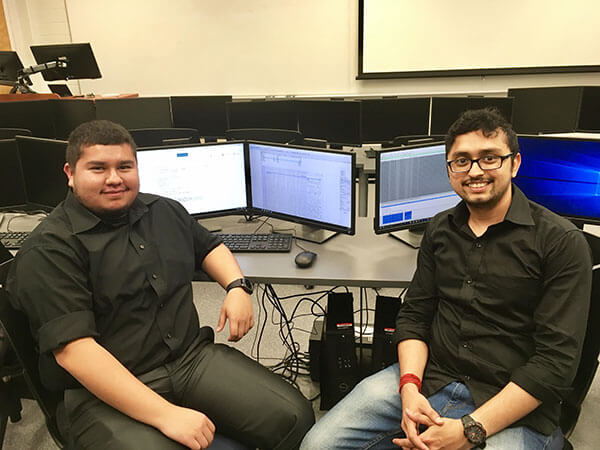 Cybesecurity graduate students Erick Buenostro and Goutham Rukmasah.