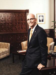 President Tom Mengler poses in his office.