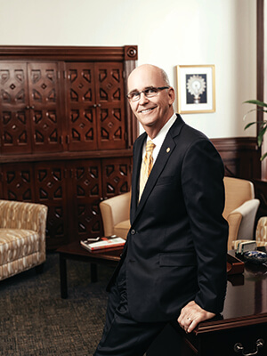 President Tom Mengler poses in his office.