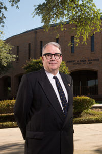 School of Law Dean Stephen M. Sheppard stands in front of the Raba Building.