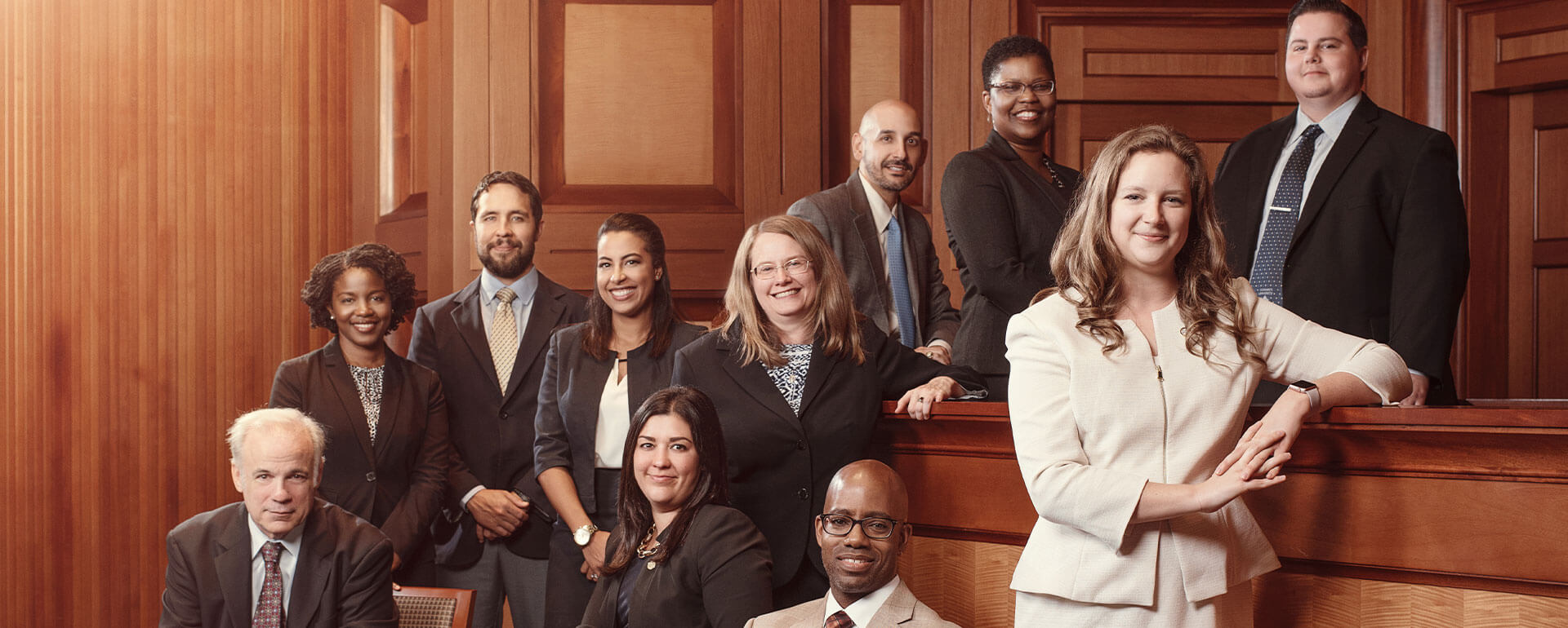 Law Success instructors pose in Law Courtroom.