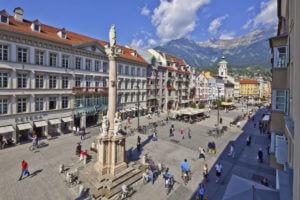 People walk across a square in Innsbruck.