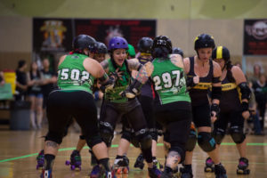 Samantha Franklin fights off roller derby opponents.