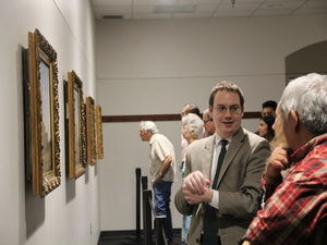 Faculty and visitors look at Gentilz paintings