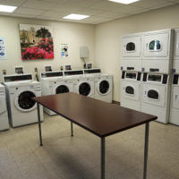 Chaminade laundry room with stacked washers and dryers