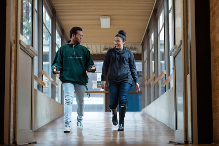 Two students walk the halls of Dougherty Hall