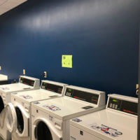 View of four industrial washing machines in Dougherty Hall