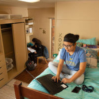 Two female students work on homework in a Dougherty Hall model room