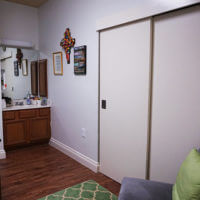 View of closet, sink, and living area inside Leies Hall