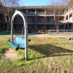 Courtyard at Leies Hall featuring a swing